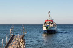 Boat approaching shore. Royalty Free Stock Images