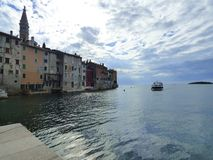 Boat approaching the shore, Rovinj, Croatia stock photo