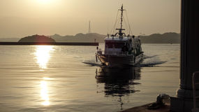 Boat approaching to port. Royalty Free Stock Photos