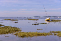 Boat at Arès in France. Sailboat at low tide at Arès, ostreicole commune located on shore of Arcachon Bay, in the Gironde department in southwestern Stock Image
