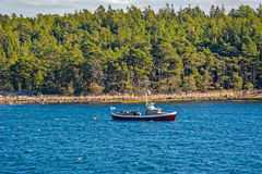 Boat in the archipel skerries Stock Photo