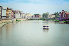 Boat in Arno river Royalty Free Stock Photos