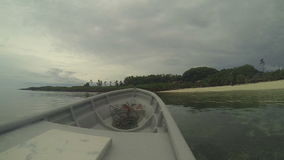 Boat arriving to a beautiful tropical island stock footage