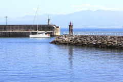Boat arriving to the port in Lastres Royalty Free Stock Image