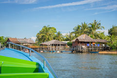Boat arriving in a traditional indonesian village Royalty Free Stock Photos