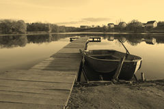 Boat ashore lake Royalty Free Stock Images