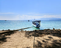 Boat on the azure shore Stock Images
