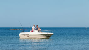 Boat back on the beach at a sea fishing competition Royalty Free Stock Image