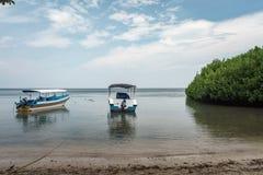 Boat on Bama Beach Banyuwangi Indonesia. This photo taken in Baluran National Park, East Java, Indonesia Stock Photo