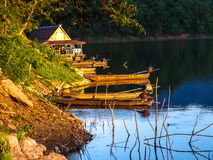 Boat. And bamboo floating house in Maethang reservoir , Phare , Thailand Royalty Free Stock Photos