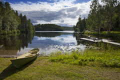 Boat on the bank of the forest lake. Finland Royalty Free Stock Photography