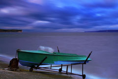 Boat on the bank of a lake Royalty Free Stock Photography