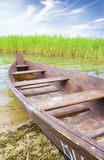 Boat on the bank of lake Stock Photography