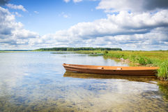 Boat on the bank of lake Royalty Free Stock Photography