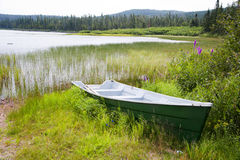 A boat at the bank of Lake Noel. Lake Noel in Reserve Faunique des Laurentides, Jacques-Cartier National Park, Quebec, Canada Stock Images