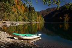 Boat on the bank of Ritsa Lake, Abkhazia. Stock Photos