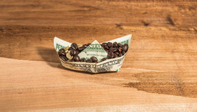 Boat banknote charge of coffee beans . Stock Photography