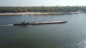 Boat with a barge on the river Dnieper stock video footage