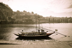 Boat with barrels of wine at the berth. Douro River. city of Por Royalty Free Stock Images