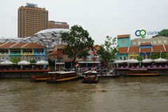 Boat and bars along the river. Boat on Singapore river. bars along the river Stock Image