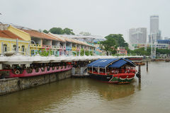 Boat and bars along the river. Boat on Singapore river. bars along the river Royalty Free Stock Photography