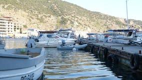 White sea boat in the bay. Boat in the bay of the black sea stock video