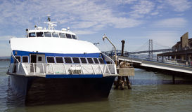 Ferry Boat in Dock and Bay Bridge San Francisco Royalty Free Stock Photos