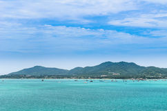 Boat in a bay with green sea and blue sky (at chalong bay, phuket Royalty Free Stock Images
