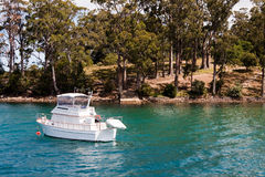 Boat in bay, Port Arthur. A boat sitting in the bay at Port Arthur, Tasmania royalty free stock photography