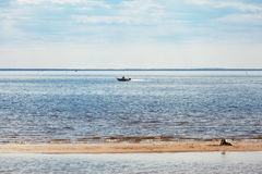 Boat in the bay on a summer day Royalty Free Stock Photography