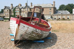 Boat on Beach. Picture of an old wooden boat on the beach at Aldeburgh, a fishing village in Suffolk, UK Stock Image