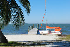 Boat on a beach. Photo of white boat on a beach, Florida, USA Royalty Free Stock Images
