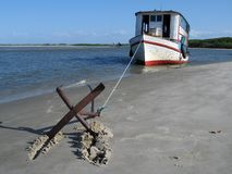 Boat in the beach. With anchor Royalty Free Stock Photos