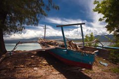Boat on the beach. Old boat on the tropical beach Stock Photography