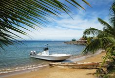 Boat by The Beach. The framed view of a boat on Coxen Hole town beach (Roatan island, Honduras Royalty Free Stock Photo