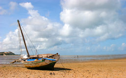 Boat on the beach. A boat stranded on the beach during low-tide in Bazaruto Royalty Free Stock Photos