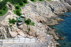 Boat on the beach. Decorative boat on a rocky seashore. Sozopl, Bulgaria Royalty Free Stock Photos