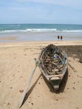 Boat on the beach. A wooden old boat on the beach royalty free stock image