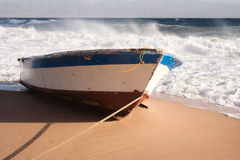 Boat on a beach. Boat resting on the sand infront of a windswept sea. Taken in Nuweiba, Egypt Stock Image