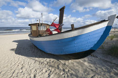 Boat on the beach Stock Images
