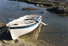 Boat on a beach Stock Photography