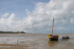 Boat on the beach. A boat stranded on the beach during low-tide in Bazaruto Stock Photos