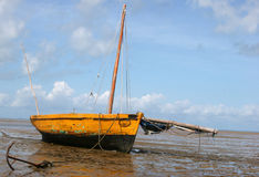 Boat on the beach. A boat stranded on the beach during low-tide in Bazaruto Stock Images