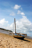 Boat on the beach. A boat stranded on the beach during low-tide in Bazaruto Stock Photo