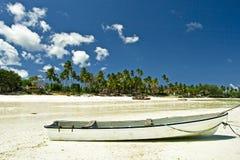 Boat on beach. Fishing boat on beach during low tide at southern Zanzibar coast Stock Photos