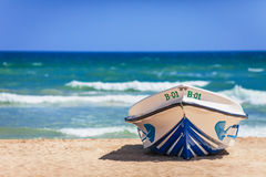 Boat on the beach as reminiscence of hot and bright summer holid Royalty Free Stock Image