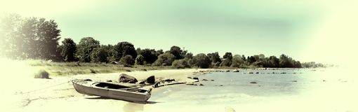 Boat on the beach of bay. Vintage Royalty Free Stock Photography