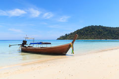 Boat on the beach with blue sky Royalty Free Stock Photo