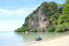 Boat on the Beach. Cliff on the beach in southern Thailand Stock Photo