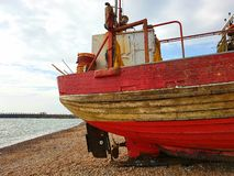 Boat beach coastline seafront sea bay trip water Royalty Free Stock Images